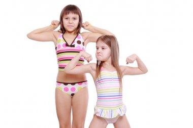 Little girls wearing summer swimsuits