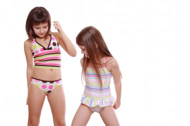 Little girls wearing summer swimsuits