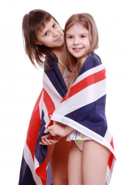 Girls in swimsuit holding British flag