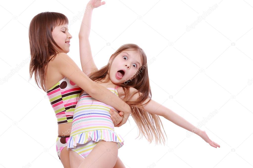 Little girls in a swimsuit — Stock Photo © Mari1Photo #41938303