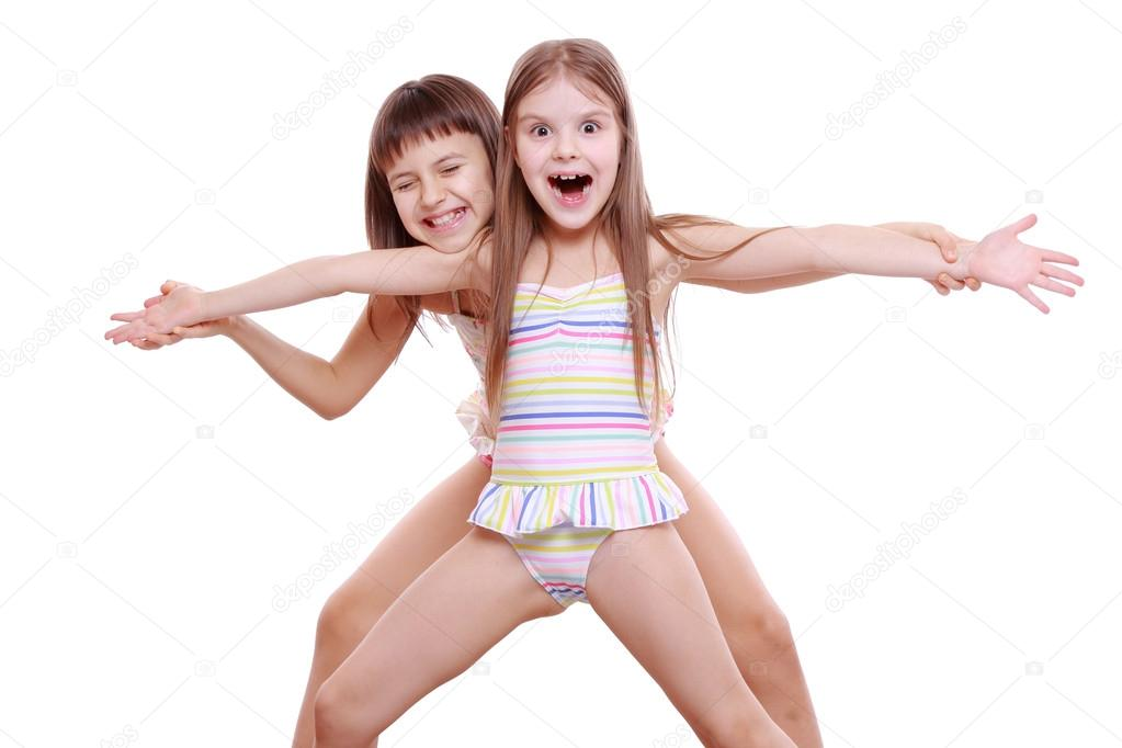 little girls in a swimsuit stock photo mari1photo