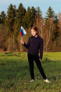 Patriotic little girl holding Russian flag