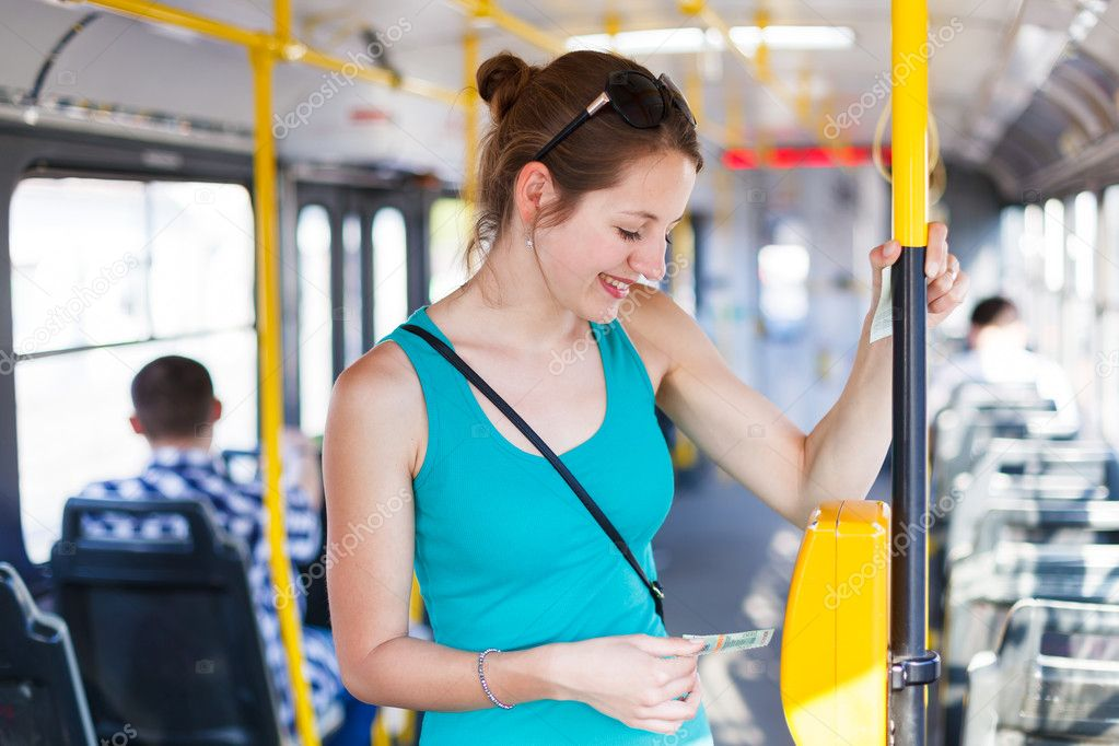 Pretty, young woman on a streetcar, tramway