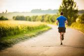 Fotografie mužský atlet, běžec na silnici