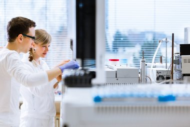 Researchers carrying out experiments in a lab