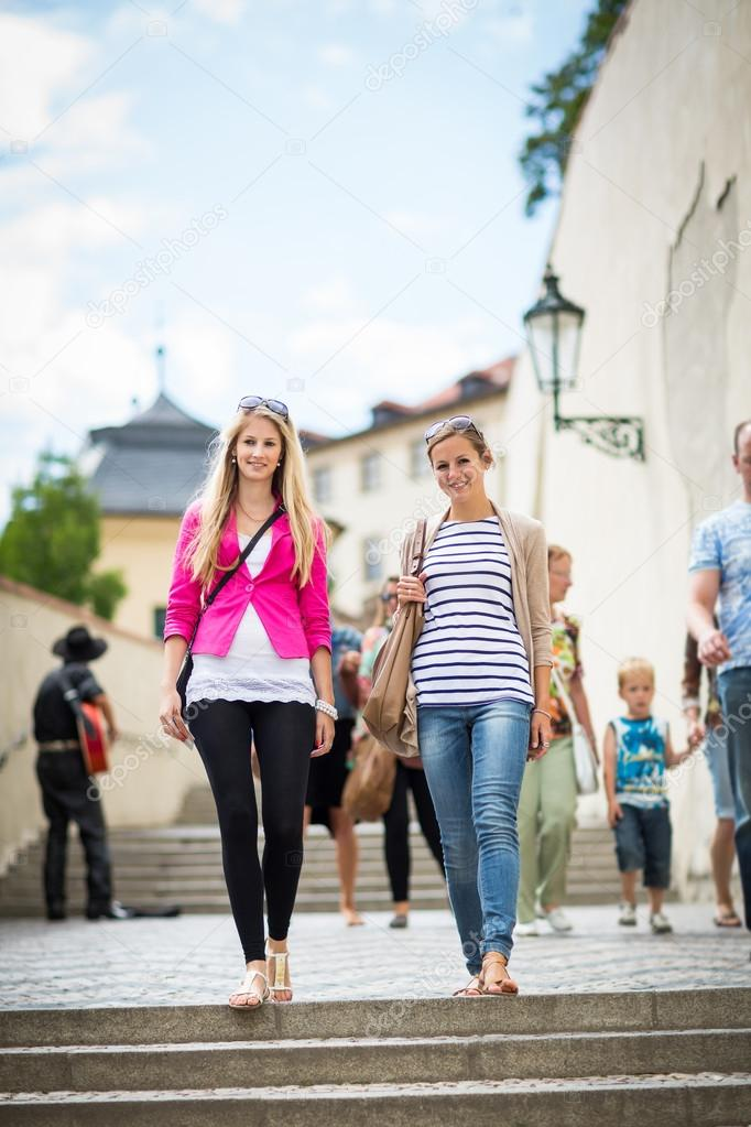 Women sightseeing in Prague historic center
