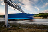 Fotografie Truck passing through a toll gate