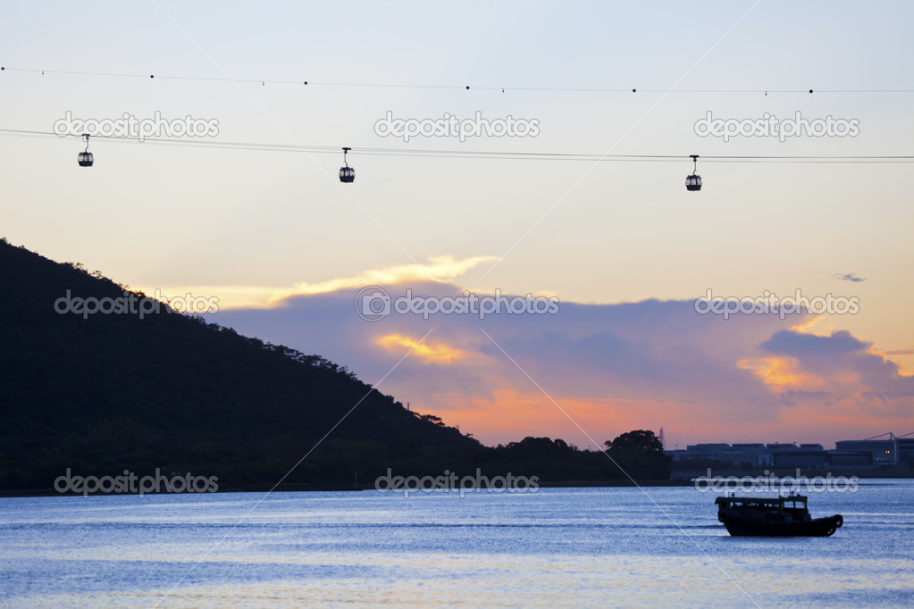 Sunset with cable cars background along coast in Hong Kong