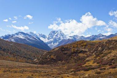 Snow mountain landscape in autumn