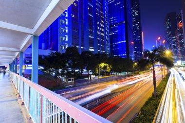 Traffic light through city at night