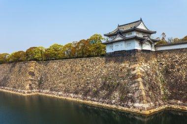 Osaka Castle along river in Japan