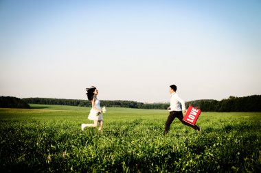 romantic couple of lovers in field runs towards each other