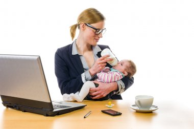 businesswoman gives baby the bottle