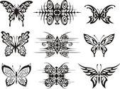 Photo Set of symmetric butterfly tattoos