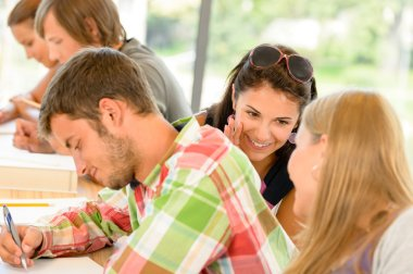 Pupils gossiping behind colleague's back in school