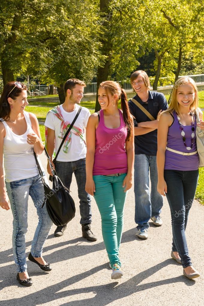 Students walking to school teens happy campus