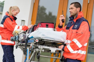Emergency radio call ambulance house door visit