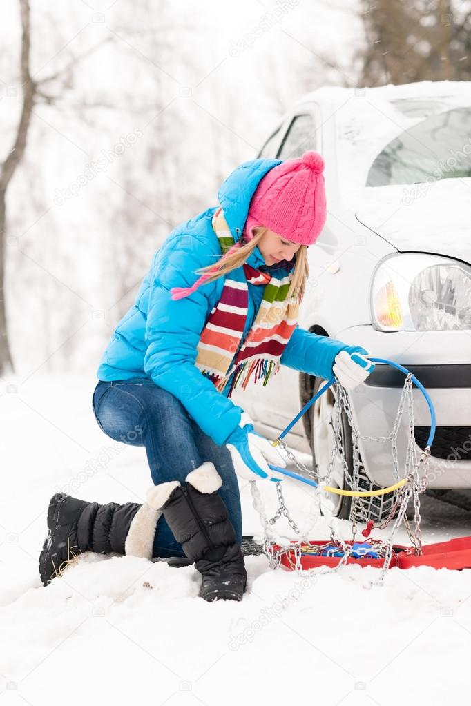 Winter car tire snow chains woman