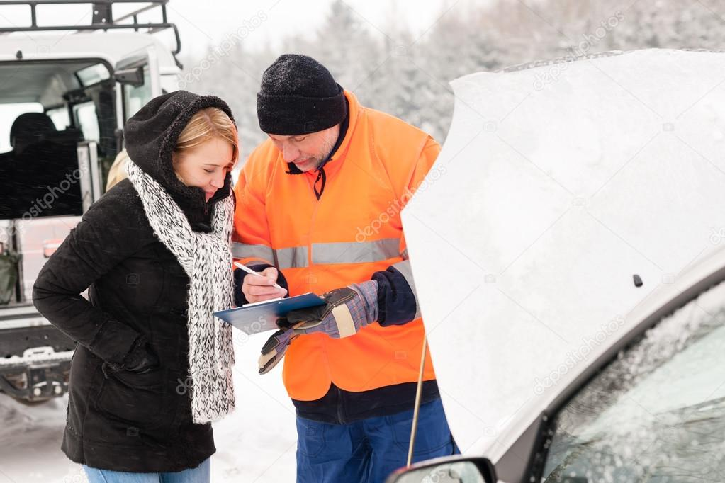 Woman fill document broken car snow mechanic