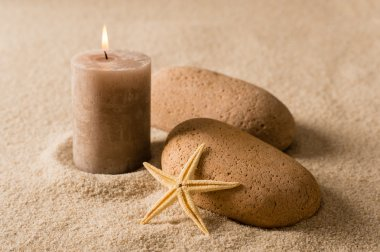 Spa still nature brown candle and stones