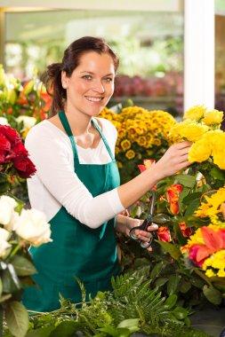 Cheerful woman flower shop market choosing working