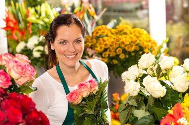 Smiling florist flower shop colorful making bouquet