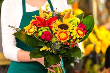 Florist holding bouquet colorful flowers shop assistant