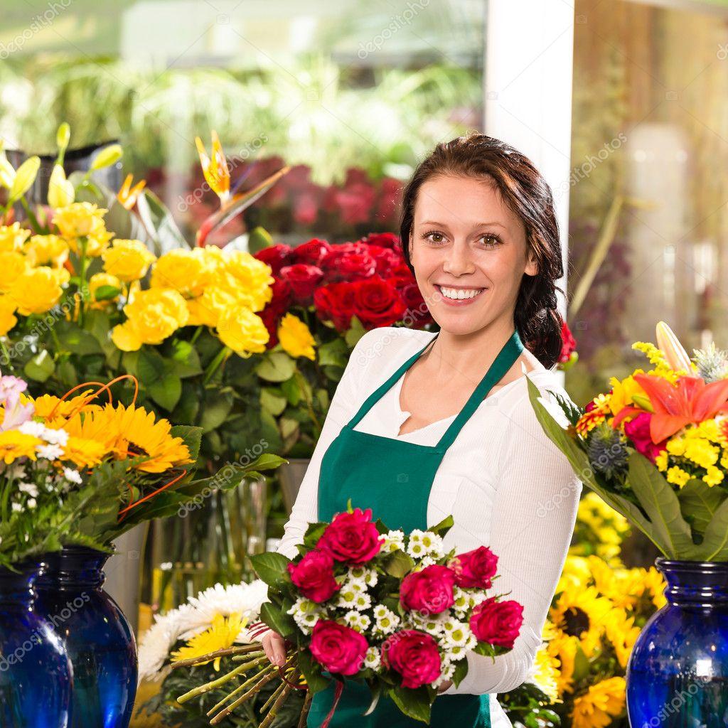 Cheerful female florist bouquet roses flower shop u2014 Stock Photo u00a9 CandyBoxImages #19857825