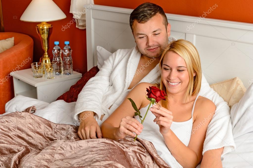 Loving couple celebrating romantic anniversary rose bed u stock