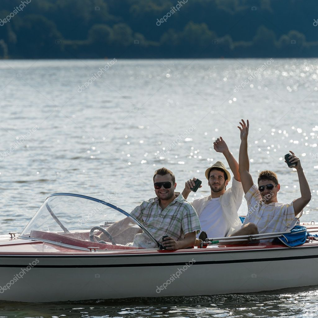 Фотообои Cheerful young men drink beer speed boat