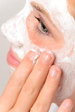 Applying mask fingers young girl beauty skin