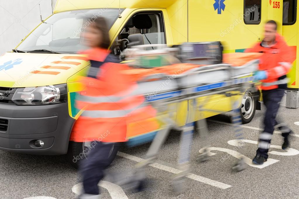 Running blurry paramedics team with stretcher