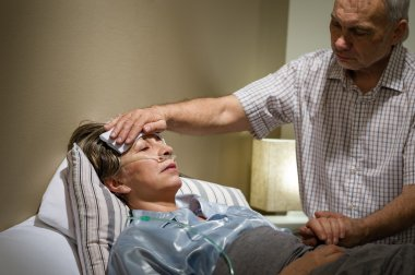 Caring senior man helping his sick wife