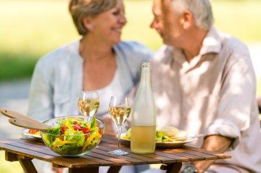 Senior couple enjoy lunch outdoor