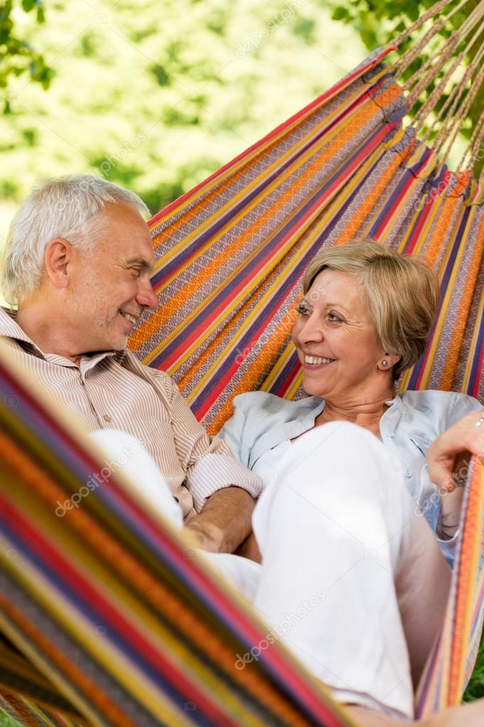 Happy elderly couple in hammock