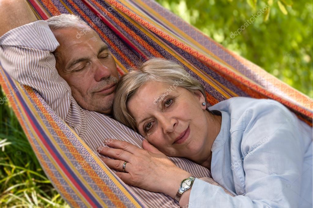 Senior Caucasian couple in hammock
