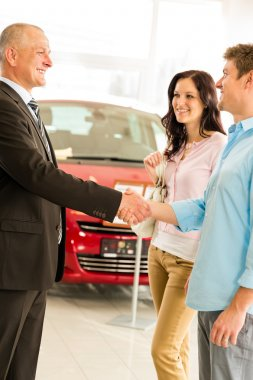 Couple making a deal with car agent