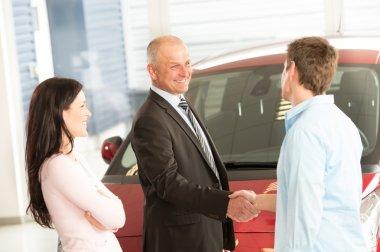 Caucasian couple purchasing a car