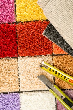 Carpet swatches, tape measure, boxcutter