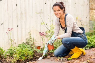 Smiling woman autumn gardening backyard hobby