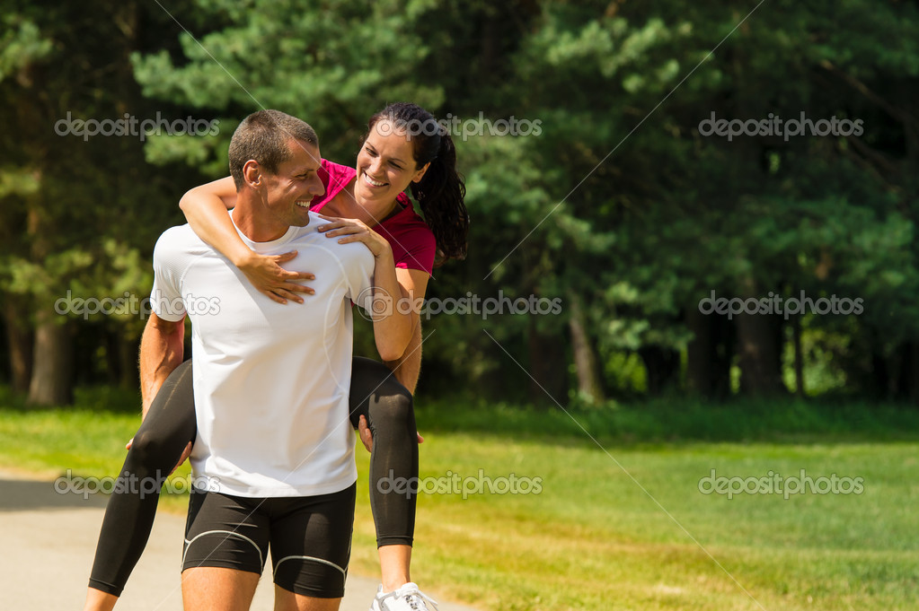 Boyfriend giving piggyback ride to girlfriend