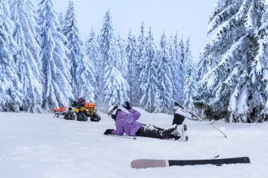 Injured skier after accident waiting for rescue