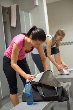 Woman at gym's locker room