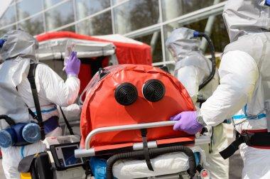 Biohazard medical team pushing stretcher towards decontamination chamber stock vector