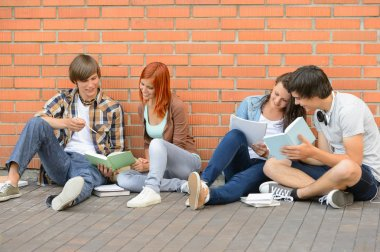 Group of students with books hanging out