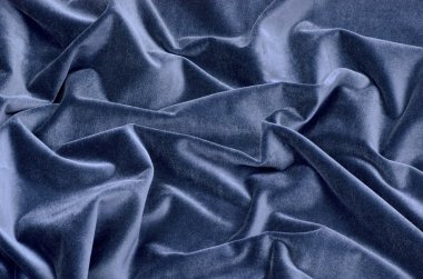 The dark blue velvet background