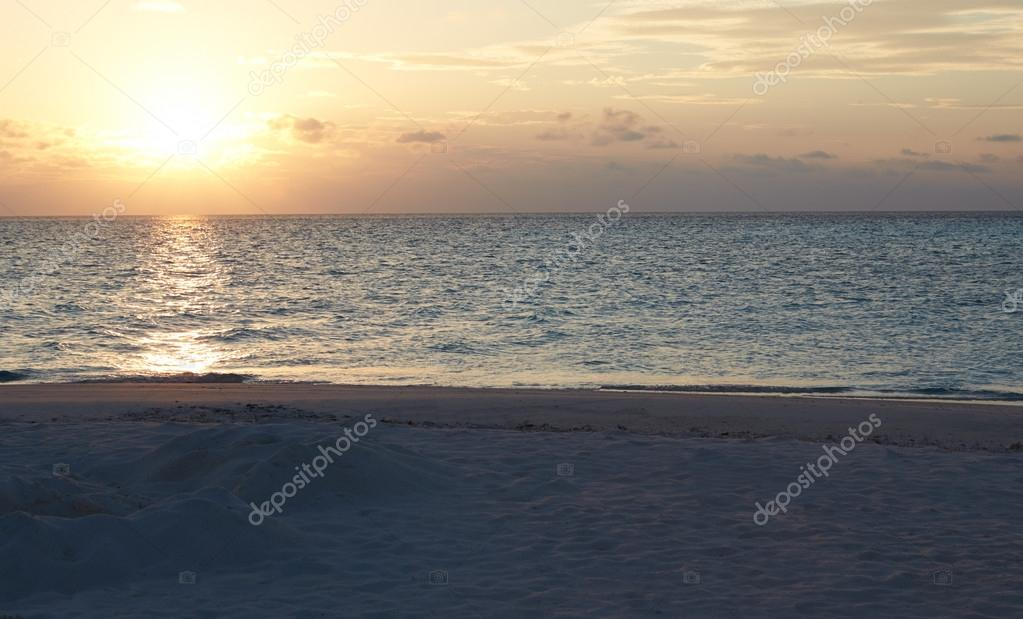 Фотообои Sun Setting Over Beautiful Deserted Beach
