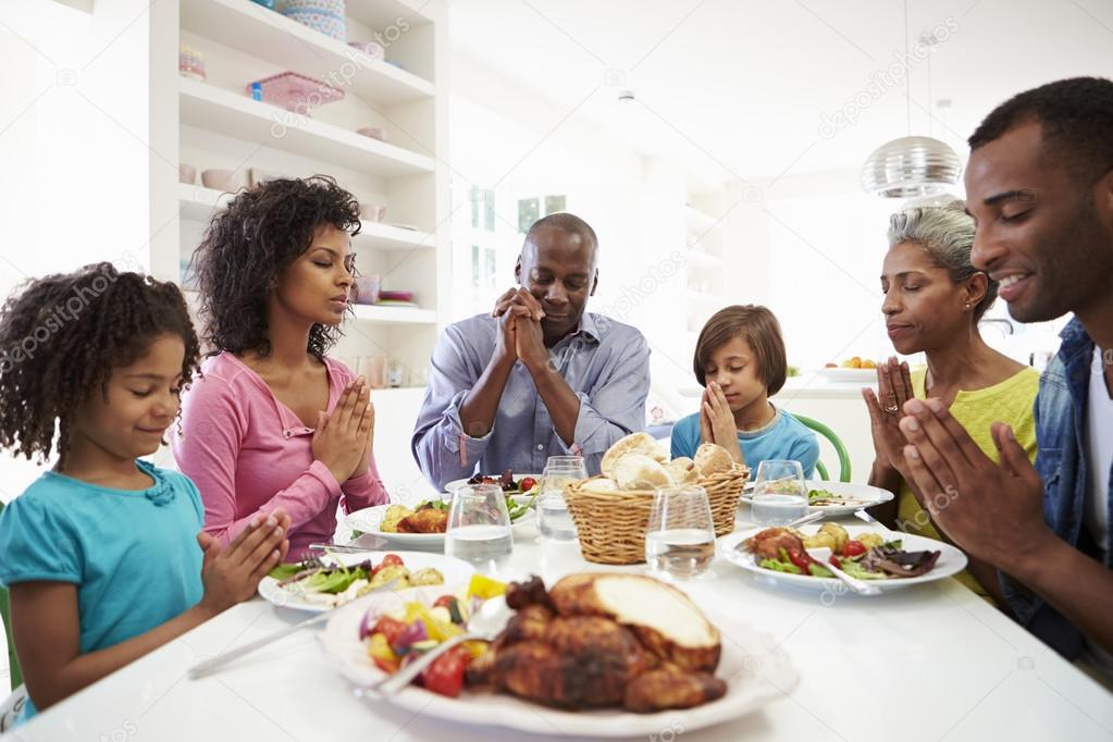 family praying around table - HD1920×1185
