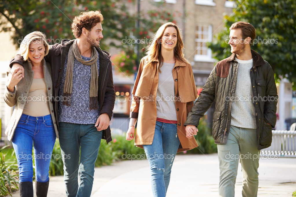 group of friends walking stock photo monkeybusiness 50698117