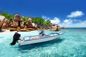 Photo speed boat on the beach of Coco Island, Seychelles